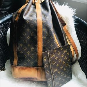 Authentic Louis Vuitton Randonne GM with wallet